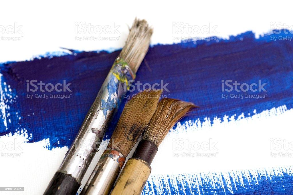Brushes on Blue Paint royalty-free stock photo