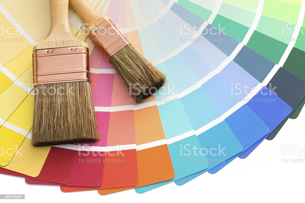 Brushes on color palette guide stock photo