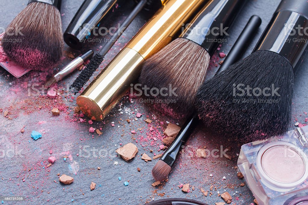 brushes on eye shadows palette stock photo