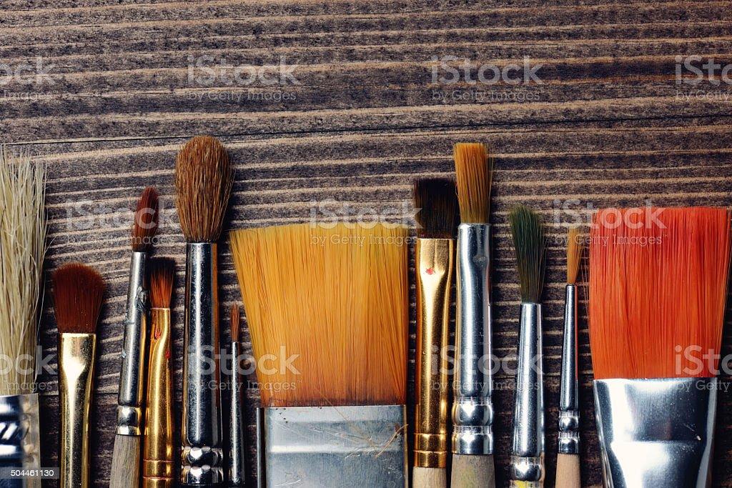 brushes on wood background stock photo
