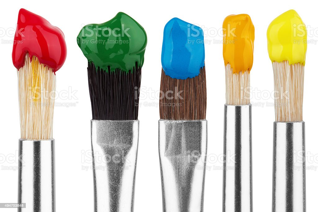 Brushes with colorful paints stock photo