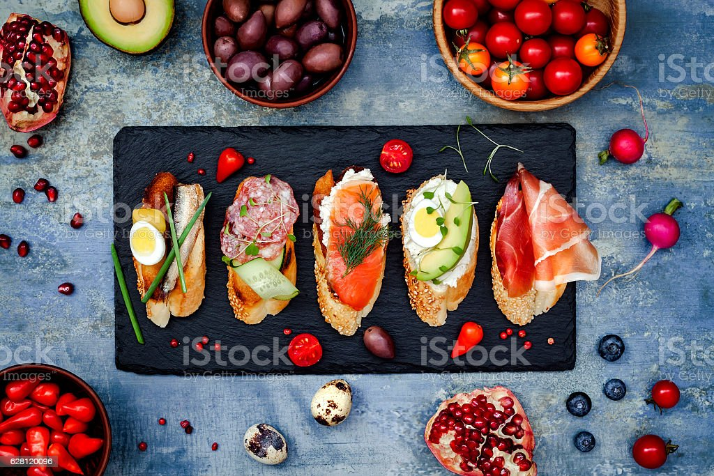 Brushetta or authentic traditional spanish tapas. Mini sandwiches food set stock photo