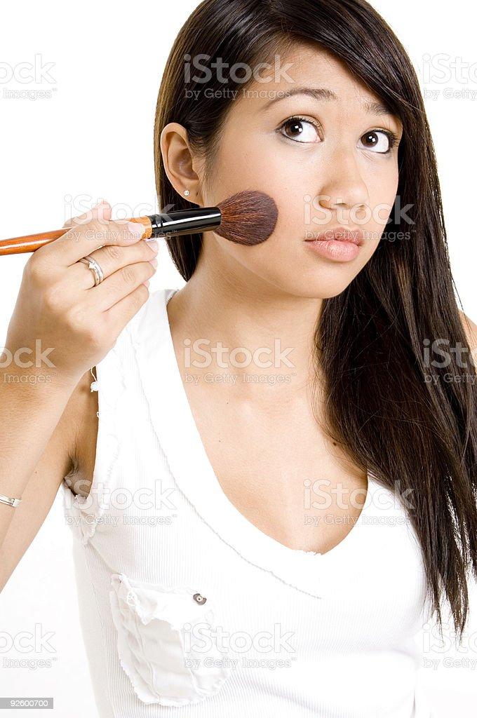 Brushing Cheek royalty-free stock photo