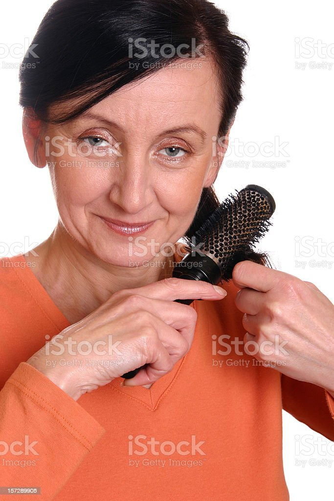 Brushing hair stock photo