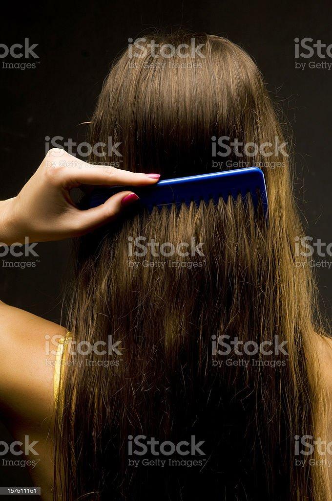 Brushing hair royalty-free stock photo