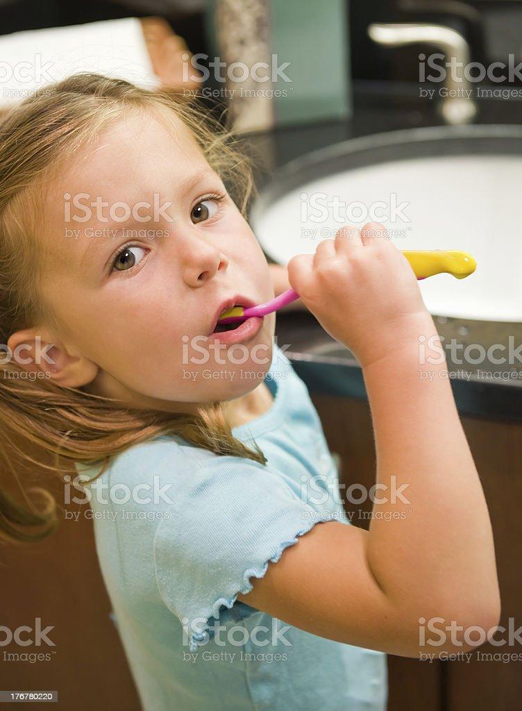 Brushing Her Teeth stock photo