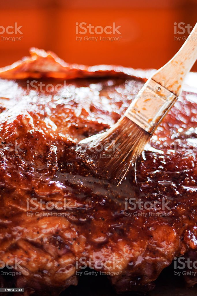 Brushing Marinade On A Prime Rib Roast royalty-free stock photo