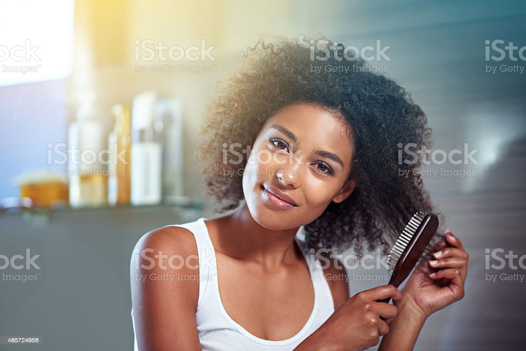 Brushing my hair but leaving the curls stock photo