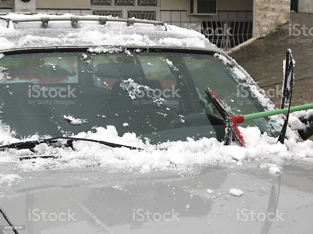 Brushing Snow Off of Windshield stock photo
