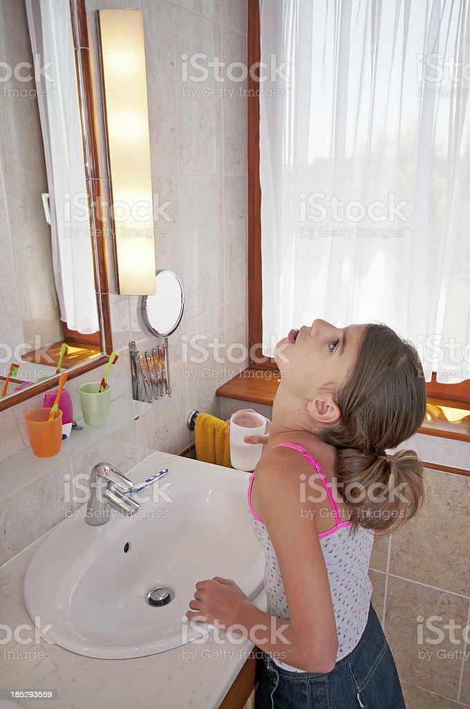 Brushing teeth in bathroom royalty-free stock photo