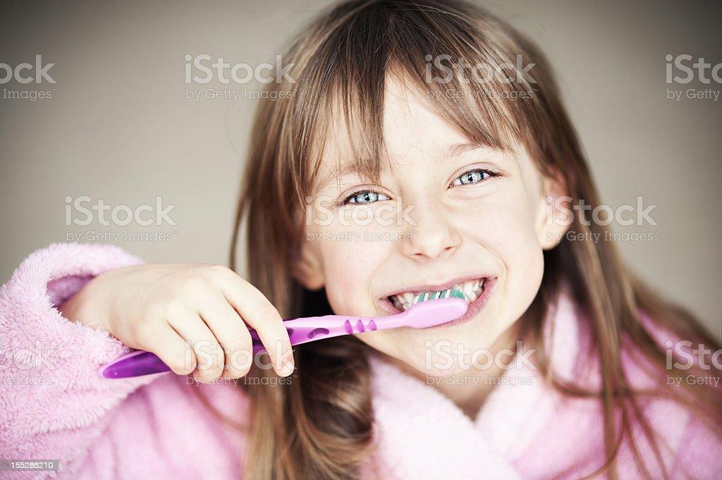 Brushing teeth is fun stock photo