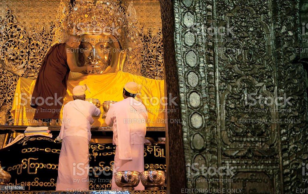 Brushing the Mahamuni Buddha's teeth royalty-free stock photo