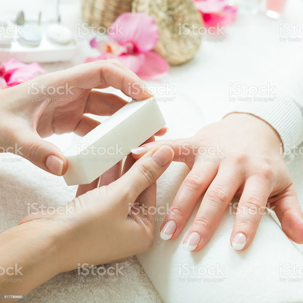 Brushing the nail for manicure stock photo