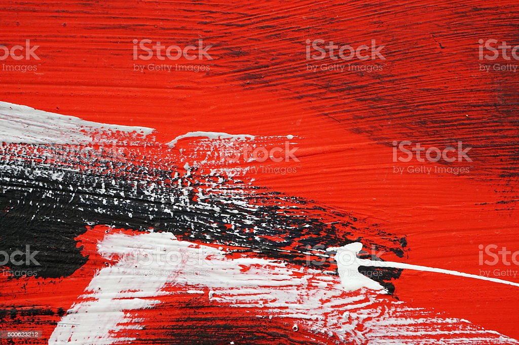 Brushstroke - white,black , red acrylic paint  on  metal surface stock photo