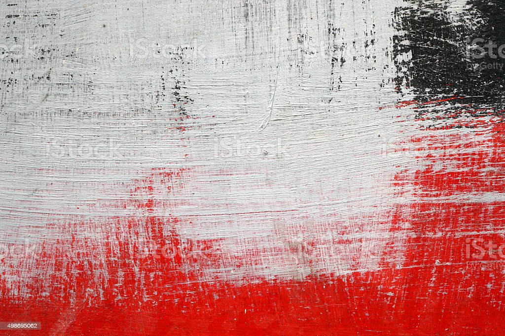 Brushstroke with white,black and red paint  on dusty metal stock photo