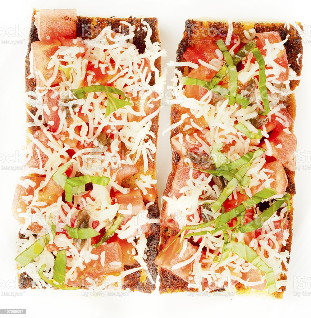 Brusketti close-up on white plate royalty-free stock photo