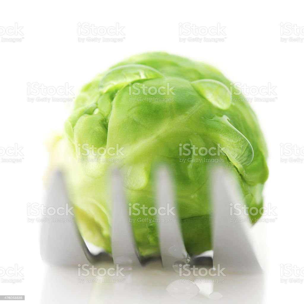 Brussels sprout on fork royalty-free stock photo