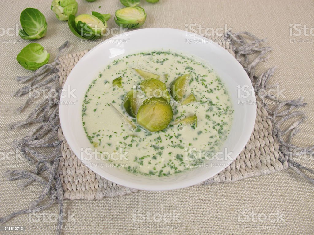 Brussels sprout soup in bowl stock photo