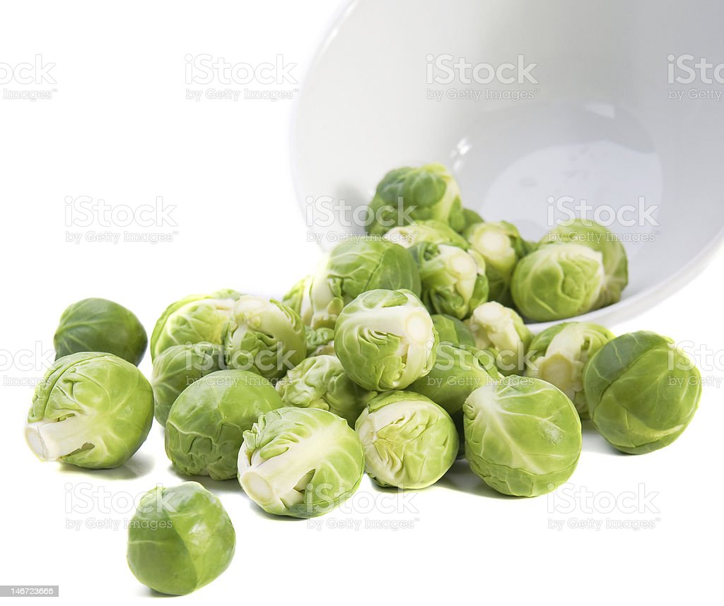 Brussels sprouts and plate on white background royalty-free stock photo