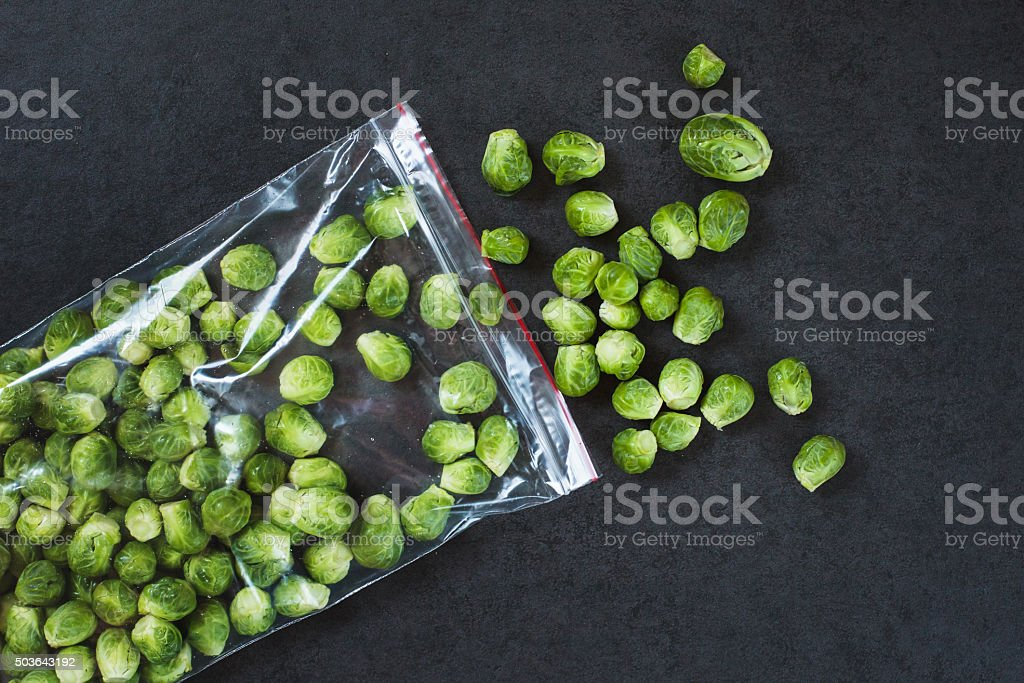 Brussels sprouts in a plastic bag stock photo