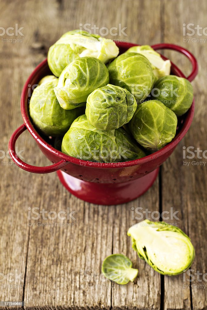 Brussels sprouts in a red colander stock photo