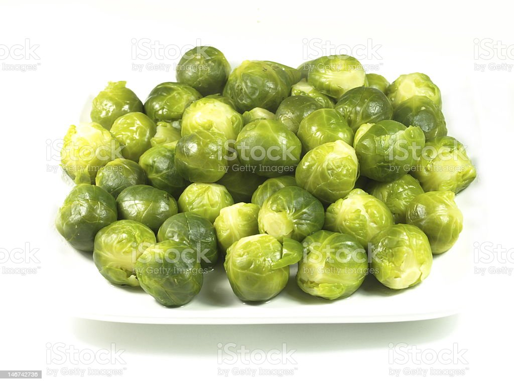 Brussels sprouts on a white plate. royalty-free stock photo