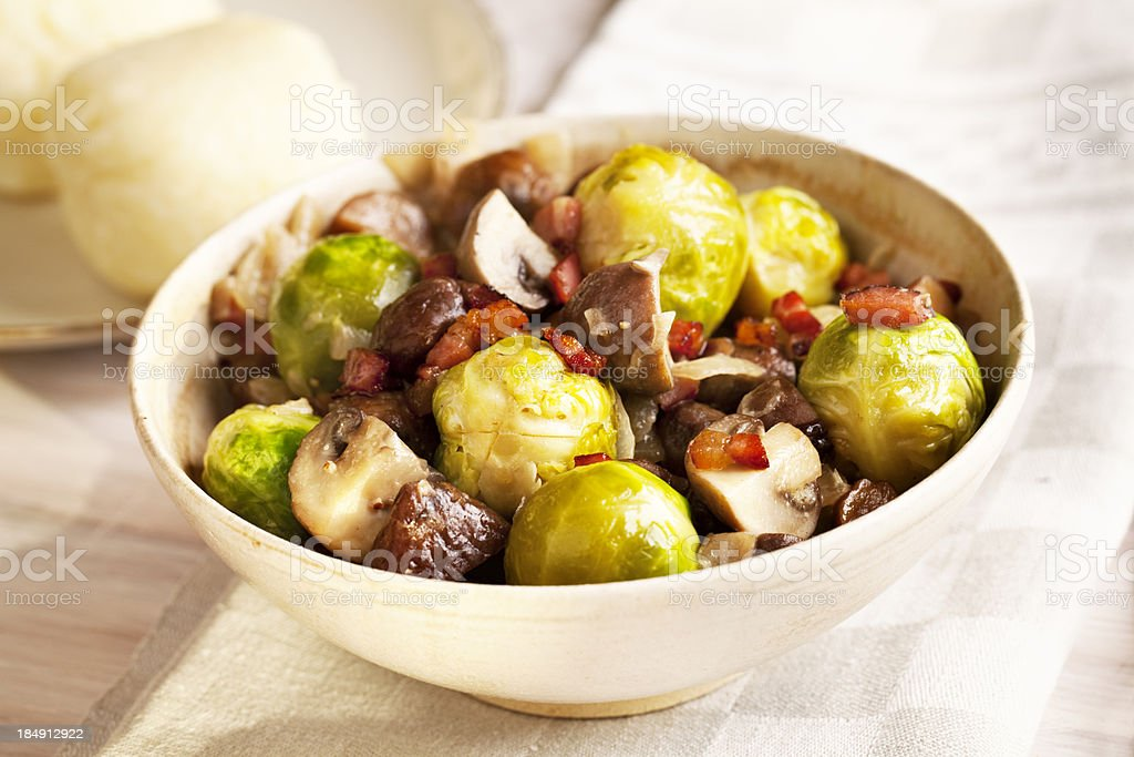brussels sprouts, sweet chestnuts and mushroom lunch stock photo