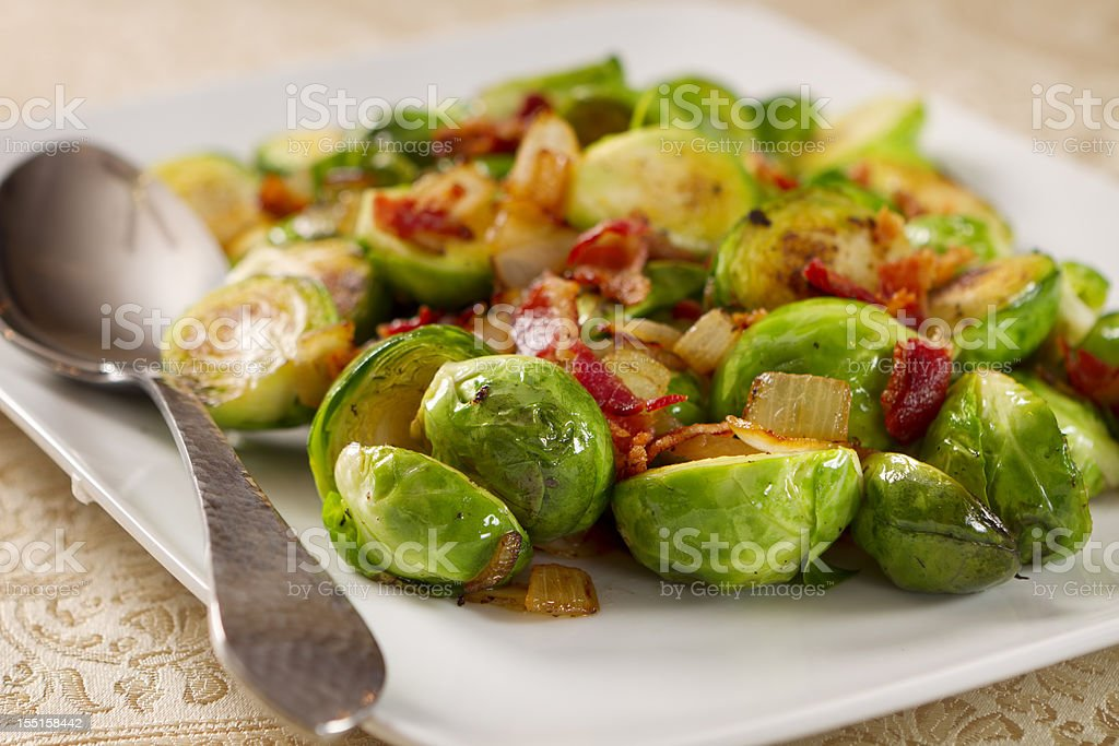 Brussels sprouts with a metal spoon stock photo