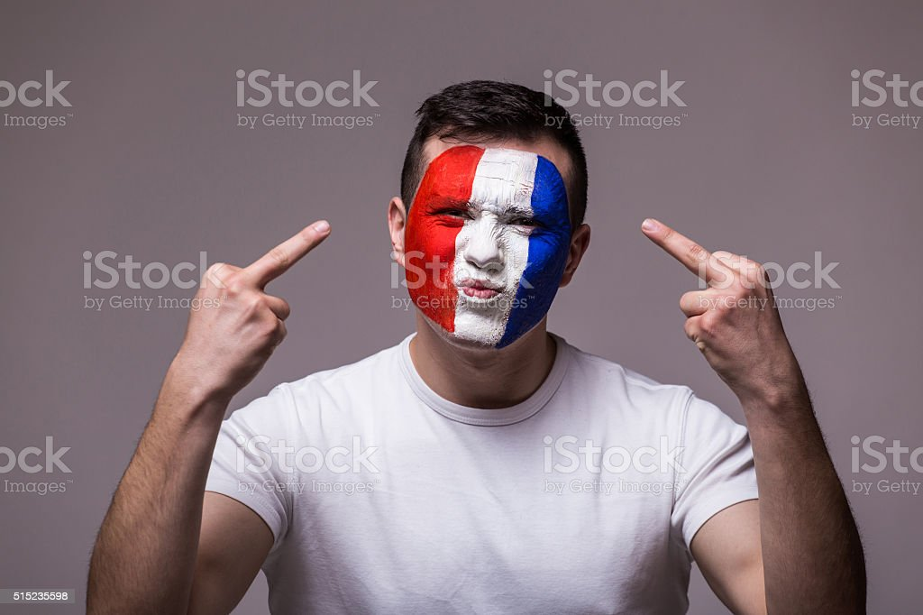 Brutal and angry huligan France football fan supporting national team stock photo