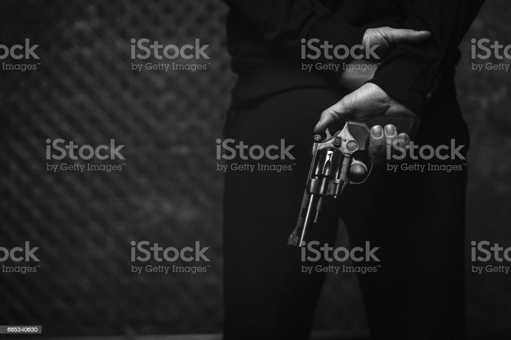 Brutal dark man planning a robbery stock photo