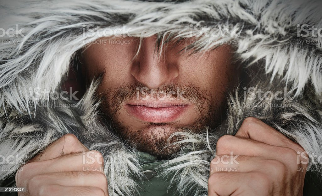 brutal face of  man with beard bristles and hooded winter stock photo