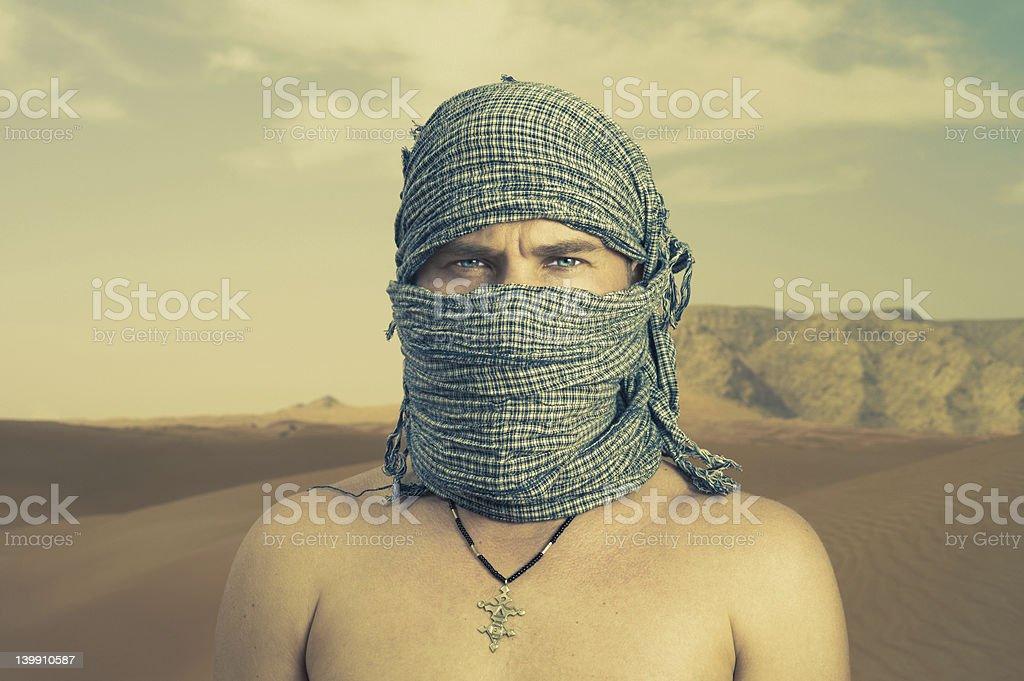Brutal man in desert royalty-free stock photo