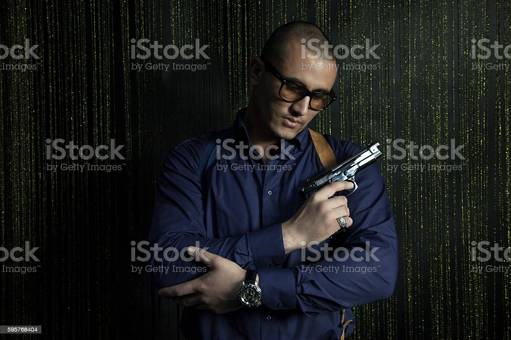 Brutal man with a gun Caucasian appearance stock photo