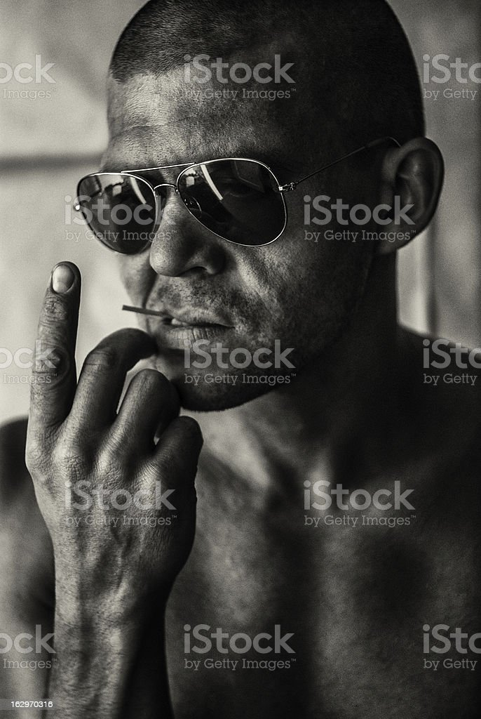 brutal man with glasses and a toothpick in his mouth royalty-free stock photo