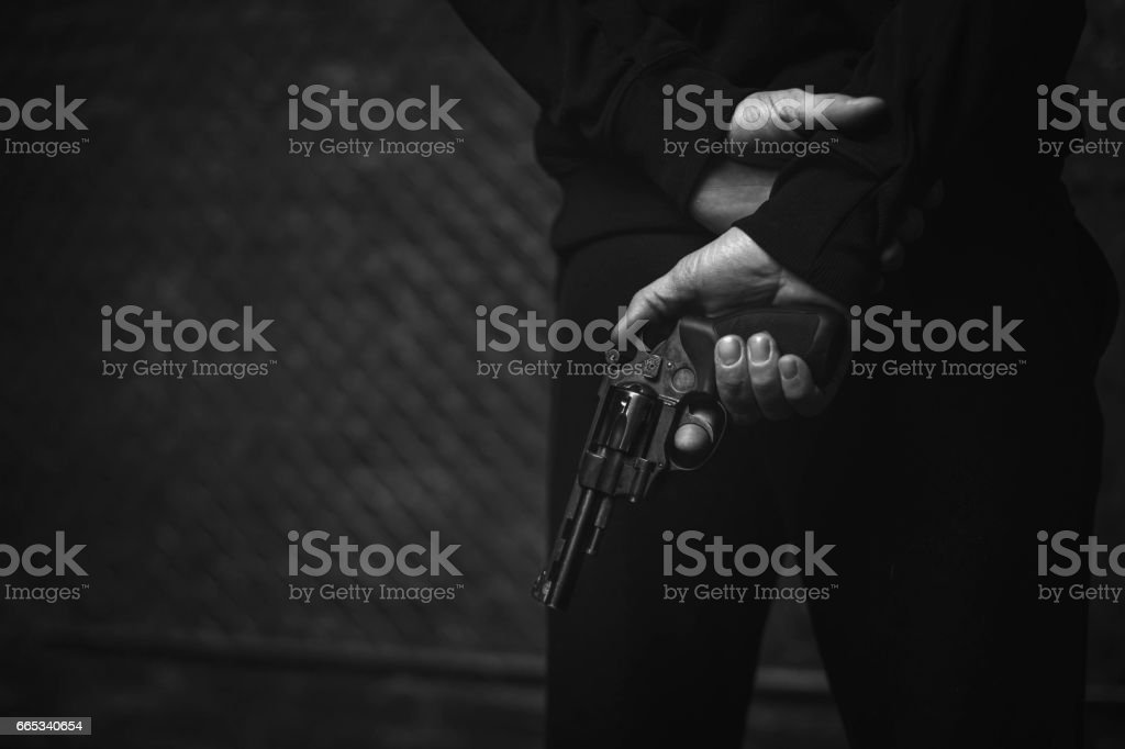 Brutal vicious criminal waiting for his victim stock photo