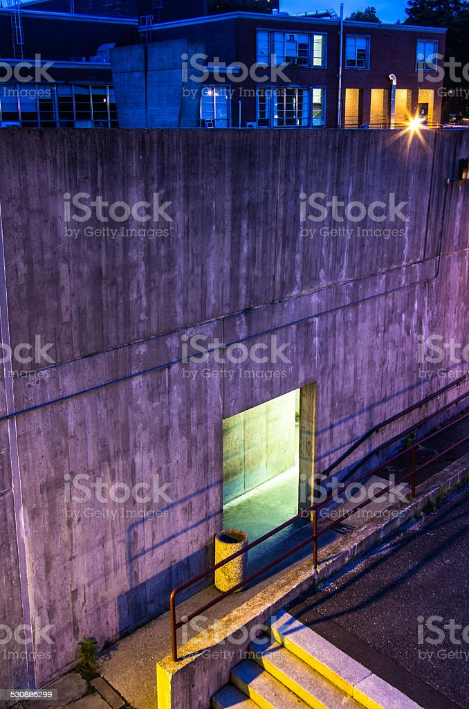 Brutalist building at UMass Amherst at night stock photo