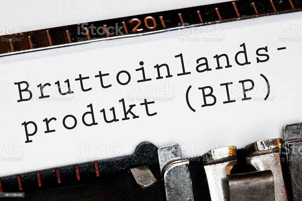 'Bruttoinlandsprodukt' typed on an old typewriter stock photo