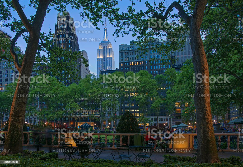 Bryant Park at Twilight with Empire State Building Lit Up stock photo