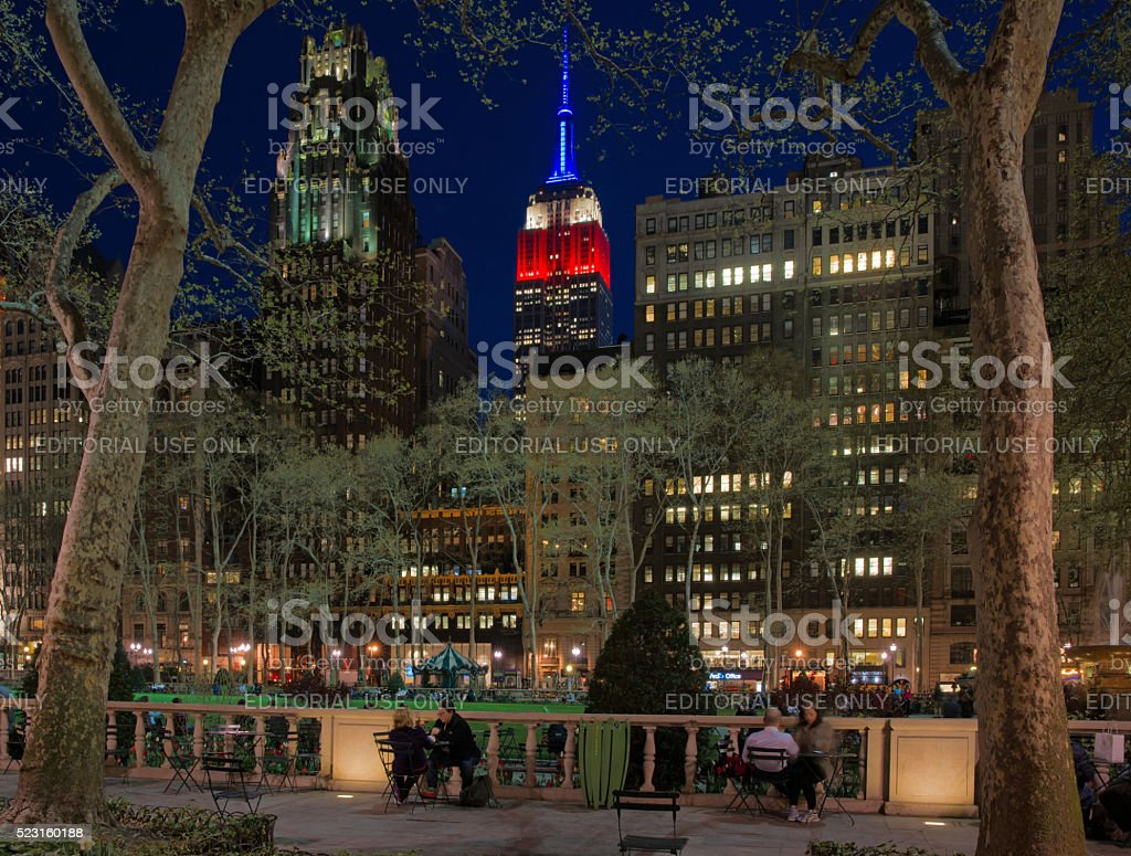 Bryant Park Spring Twilight with Empire State Building Lit Up stock photo