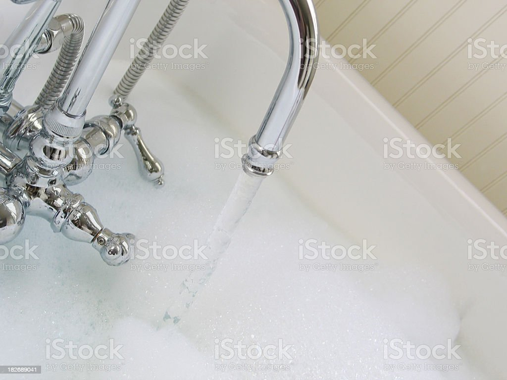 A bubble bath being drawn and almost full royalty-free stock photo
