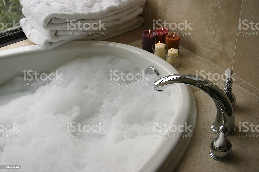 bubble bath with candles, towels stock photo