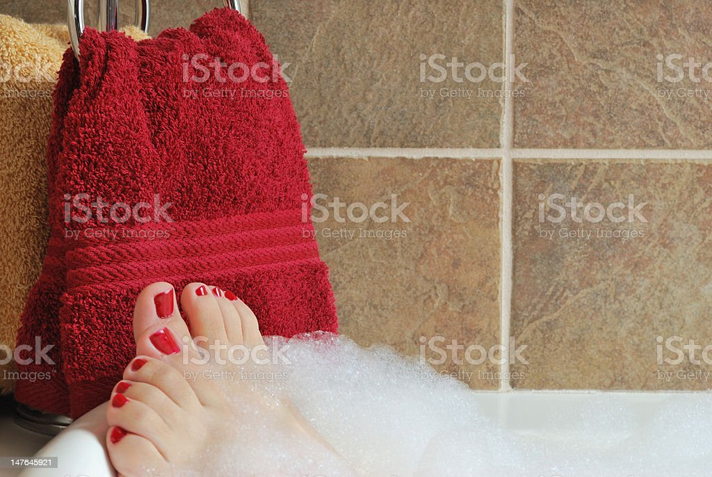 Bubble bath with red toes royalty-free stock photo