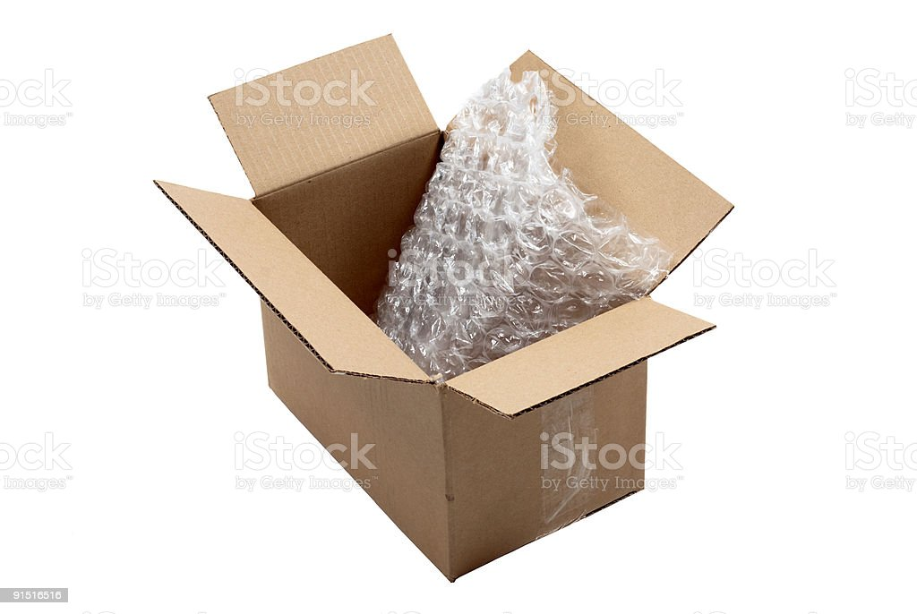Bubble wrap in open cardboard box stock photo