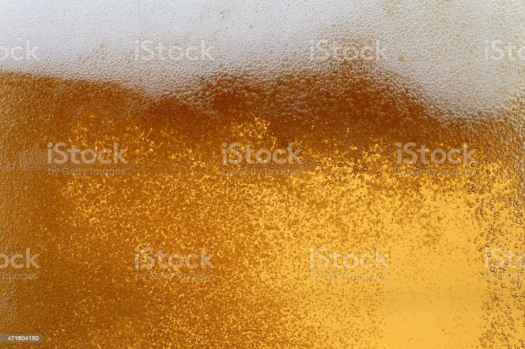 Bubbles and foam in a beer stock photo