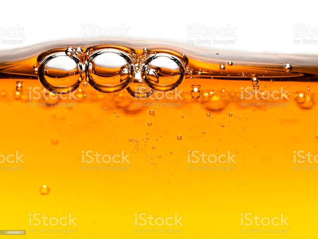 Bubbles in orange liquid soap royalty-free stock photo
