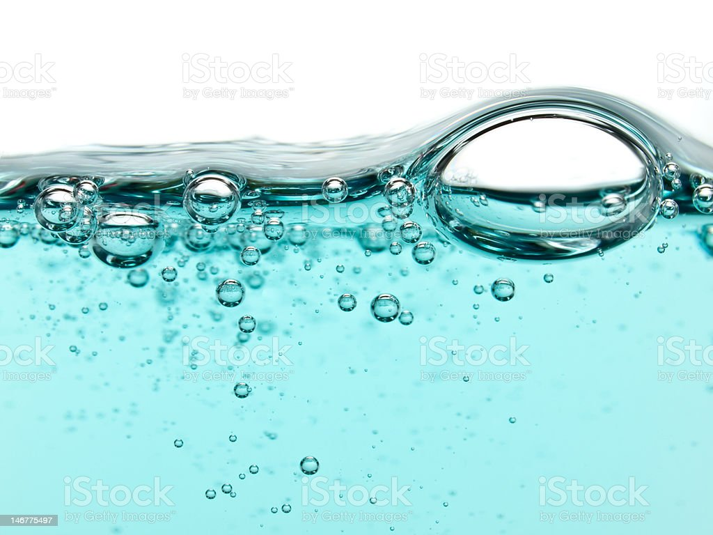Bubbles in turquoise liquid soap stock photo