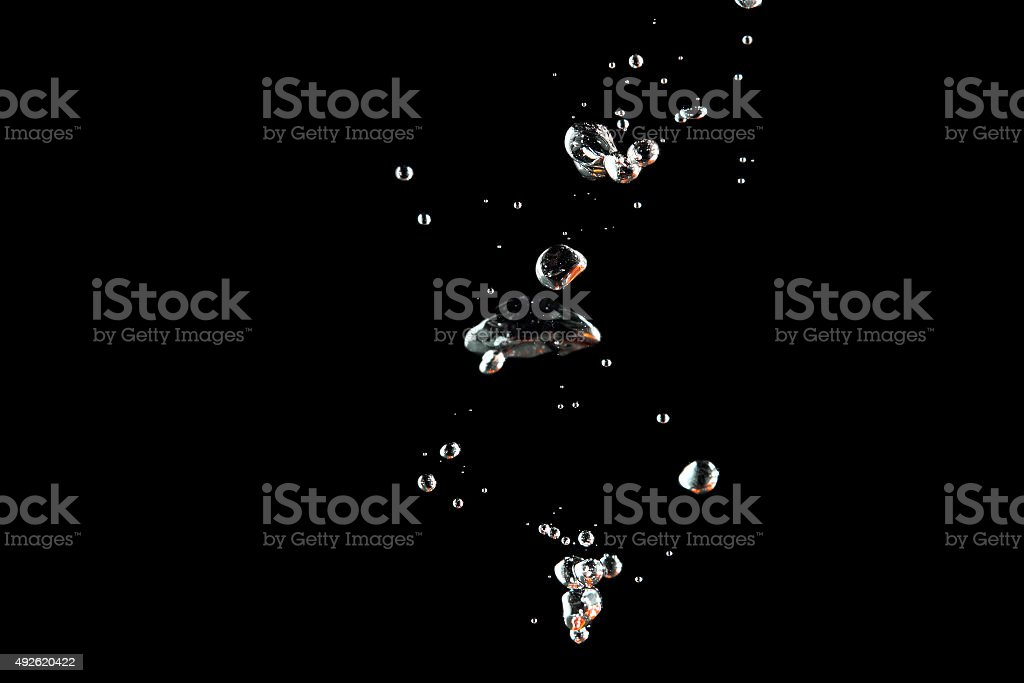 Bubbles water at black background stock photo