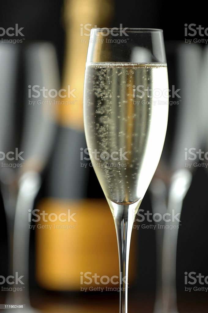 Bubbling Champagne Flutes and Bottle on Black royalty-free stock photo