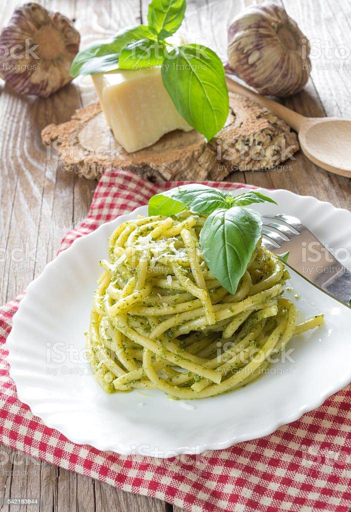 bucatini pasta by pesto stock photo