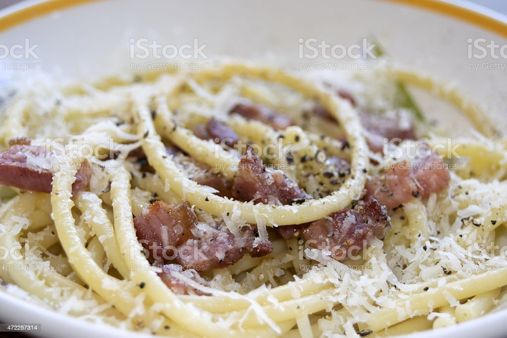 bucatini with bacon stock photo